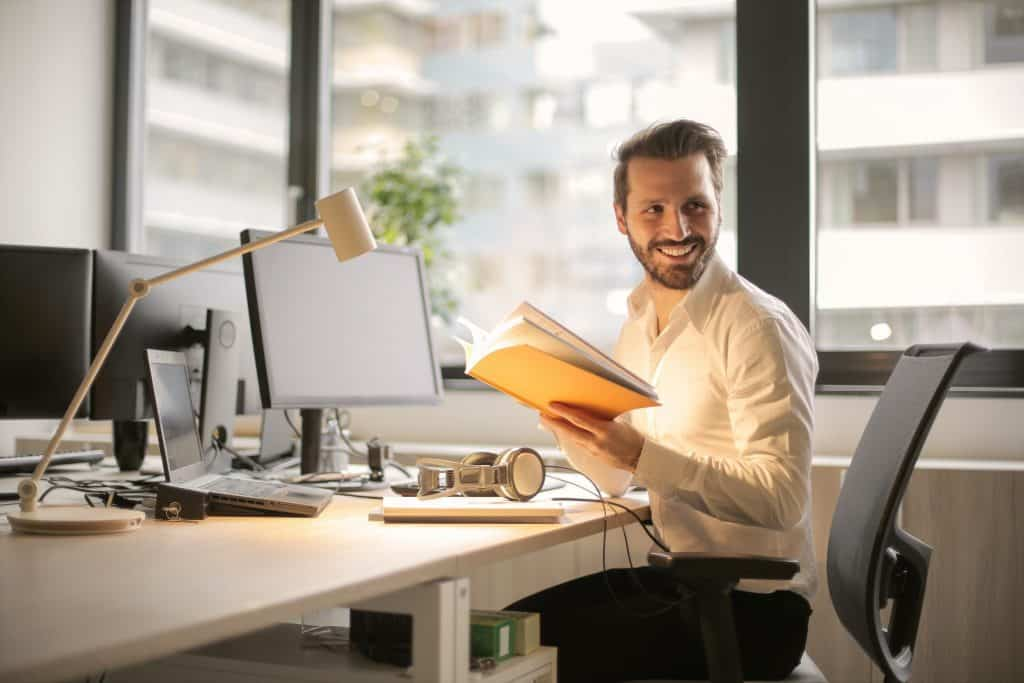 Male smiling while working
